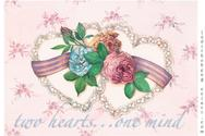 Two lace hearts with flowers